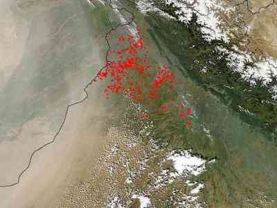 A satellite look at dust and smoke from fires over northwestern India and Pakistan. These fires may contribute to a change in rainfall patterns over the region. [CREDIT: NASA]