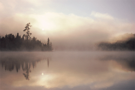 Cooling aerosol particles create a fog over a lake.  [CREDIT: RAP.UCAR.EDU]
