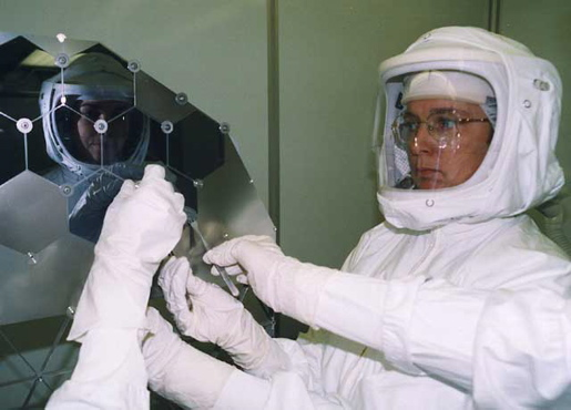 Dr. Eileen Stansbery assembles a delicate solar array in NASA's cleanest room in 2002. [CREDIT: NASA]