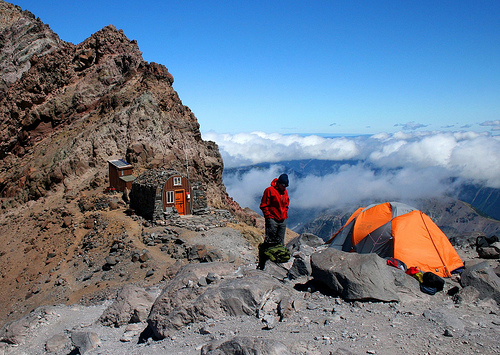 How can high altitude climbers survive with so little oxygen?
