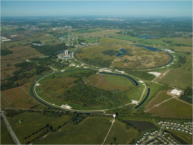 An aerial view of Fermi National Accelerator Laboratory, where in September 2011 the lab had to shut down the Tevatron particle accelerator, which at one time was the most powerful in the world. [Image credit: Flickr user Fermilab Communication]