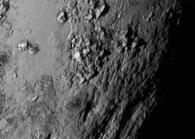 Close-up images of Pluto's equator reveals mountains that are far taller than expected. [Image credit: NASA/JHUAPL/SwRI]
