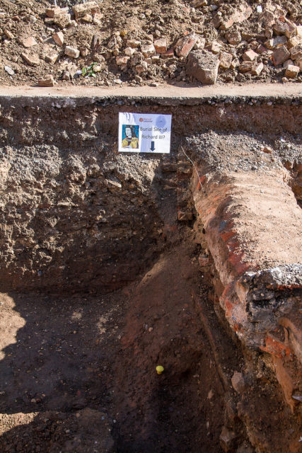 A small sign marks the site where remains later identified as Richard III's were discovered. [Image credit:
