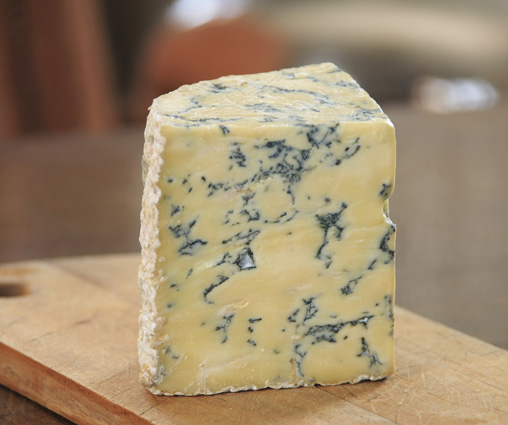 Blue cheeses like Stilton are named for the blue fungus running through the cheese. [Image credit: Designgeist | CC BY 3.0]