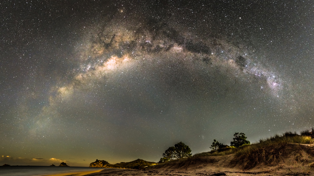 A panorama of the Milky Way over the Coromandel Peninsula in New Zealand.
