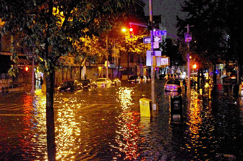 A flooded street at night in Manhattan's East Village.