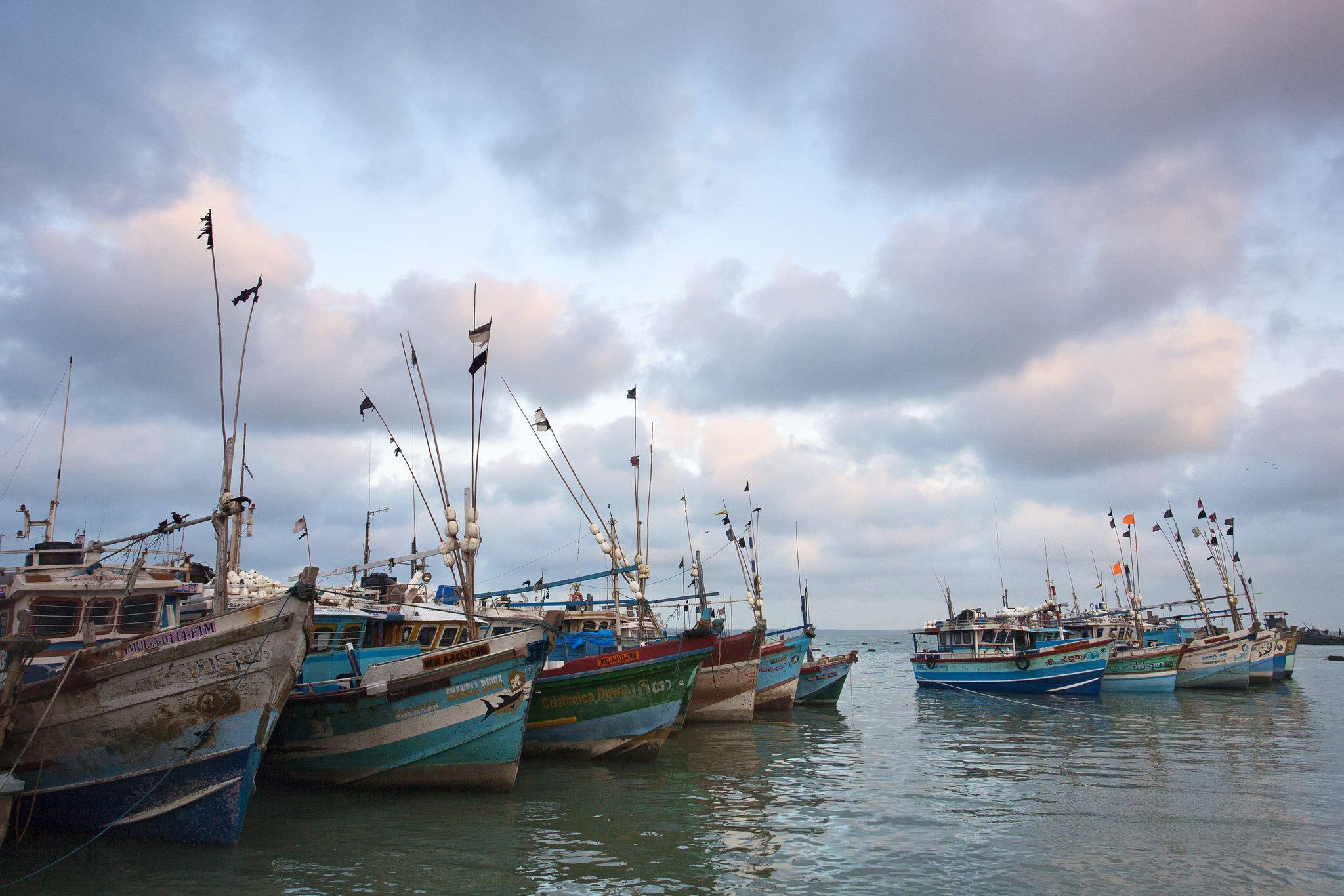 Small fishing boats at dock.
