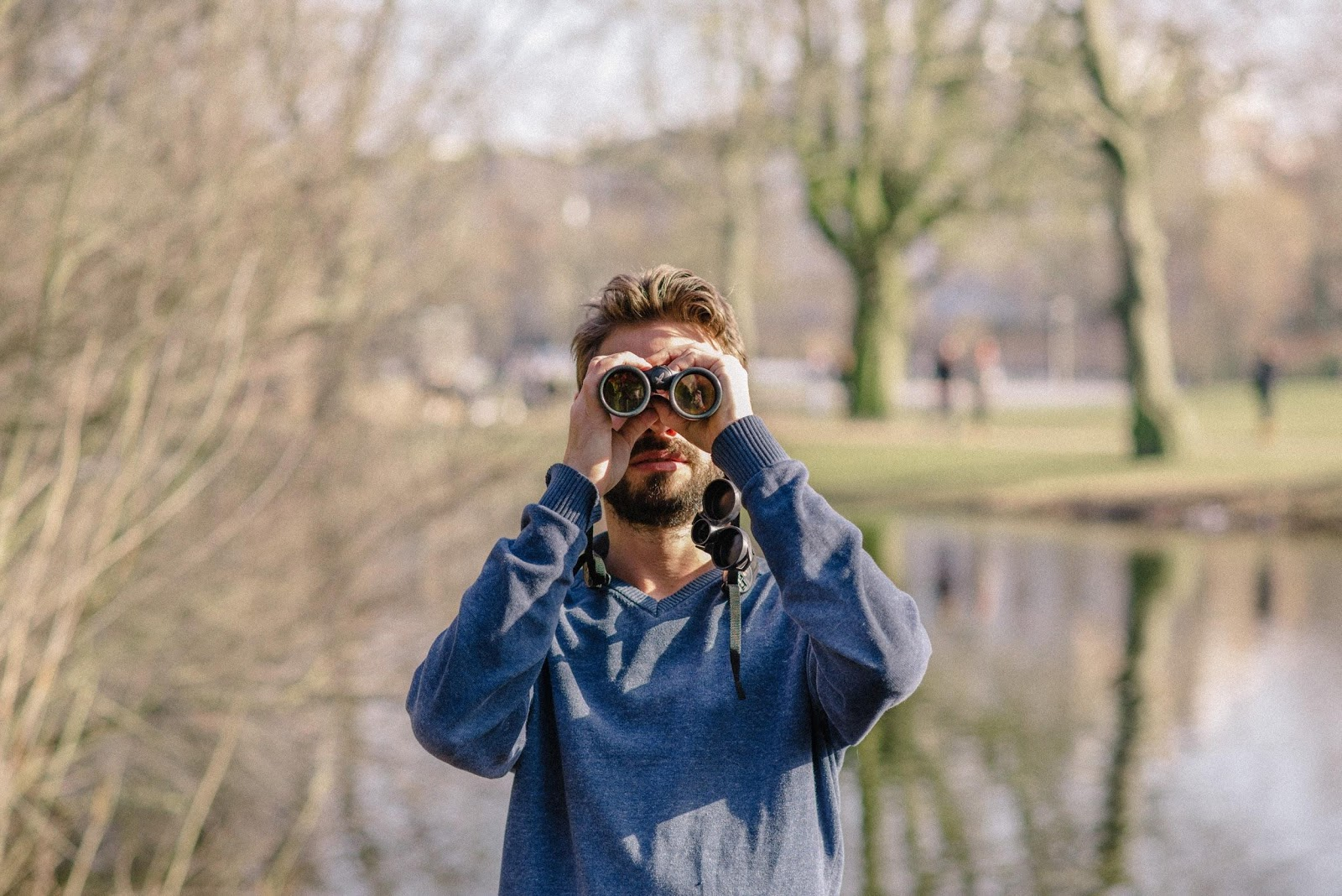 Arjan Dwarshuis looks through his binoculars