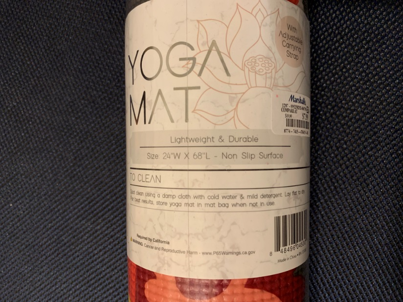 Yoga mat with cancer warning label.