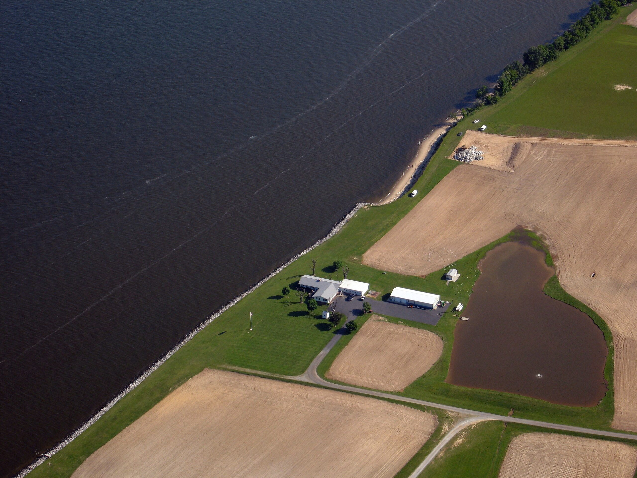 Farm on the edge of northern Chesapeake Bay, with little vegetation buffer and riprap shoreline