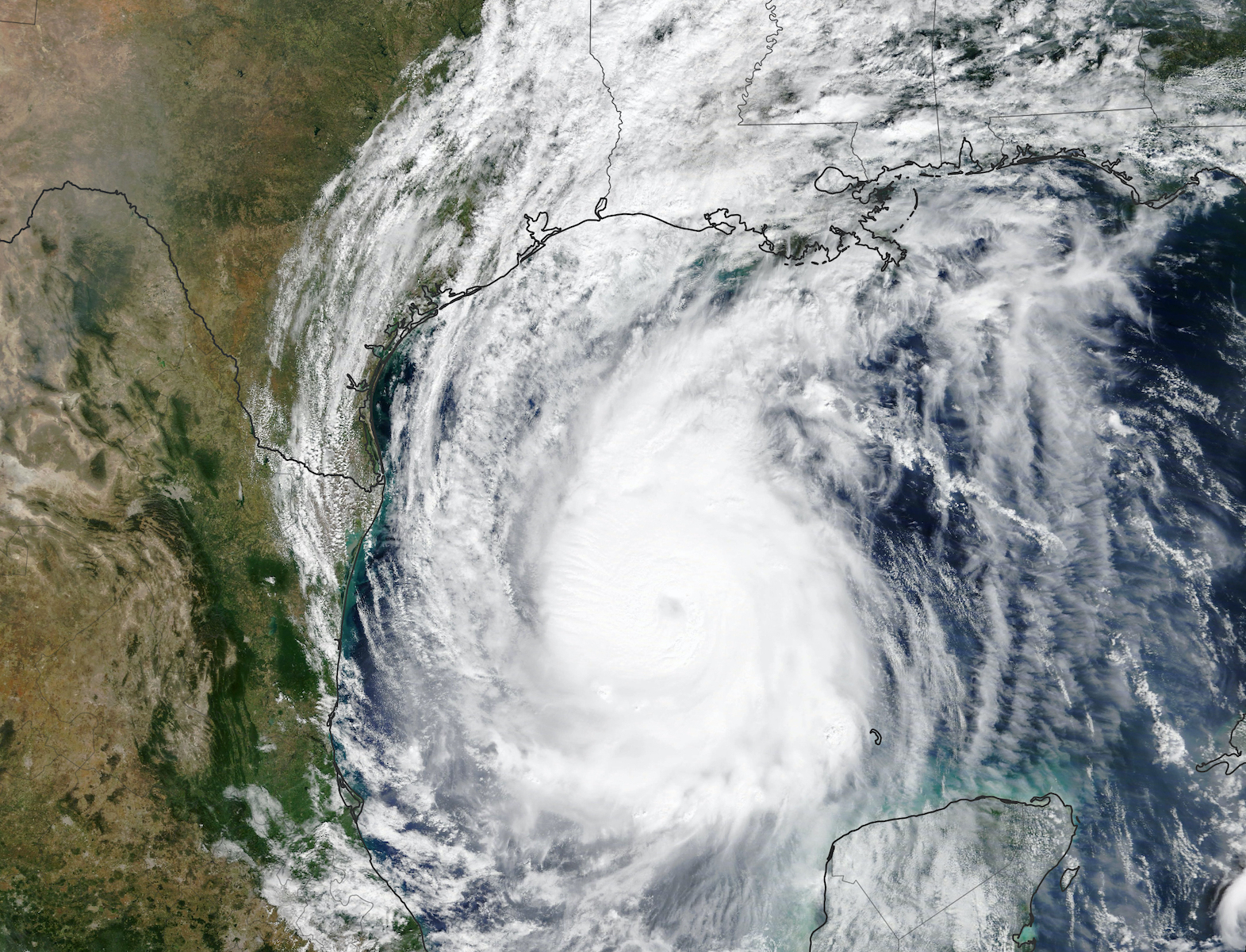 A color satellite image of Hurricane Delta swirling above the Gulf Coast