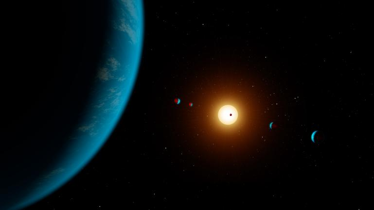 An artist's interpretation of the K2-138 system, including 6 planets and 1 star.