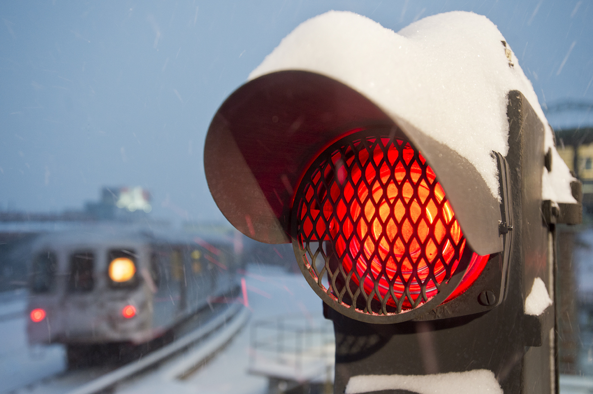 A New York City Subway signal light in the snow.